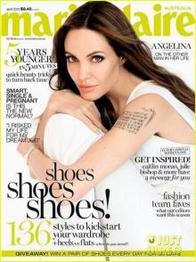 แองเจลิน่า โจลี่โชว์ยันต์รอยสักลงนิตยสาร